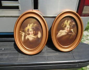 Antique 1897 Coppery Gold Tone Metal Framed Victorian Cupid Awake Cupid Asleep Prints Tin Oval Picture Frames