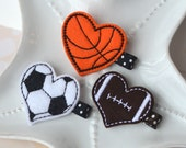 2 soccer hearts on a French barrette