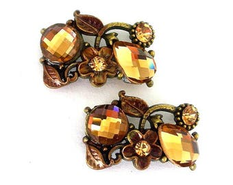 2 bronze 2 hole slider beads, floral brown, two hole buttons, spacers, light smoked topaz crystals