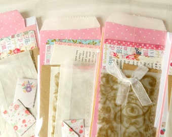 A *pink* PACK-of-POCKETS. A selection of pouches, envelopes & pockets for travel journals, scrapbooking, and all your crafty doings