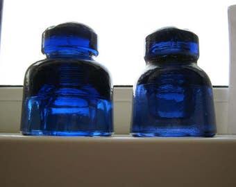 Free shipping. Couple of deep cobalt blue old insulator