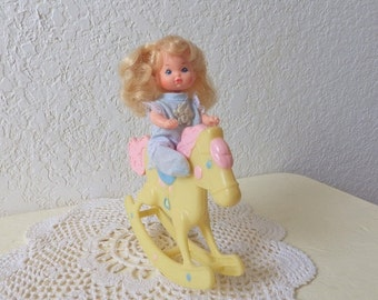 Heart Family Baby Doll riding Rocking Horse, 1980s.