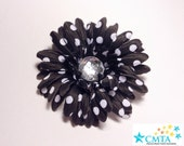 One black and white polka dot hair flower with rhinestone. Portion of sale goes to charity.