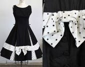 Vintage 1950s Black Fit and Flare Dress With Polkadot Bow / New Look Dress Bullet Bra Button Detail Polka Dot Full Circle Skirt Gothic