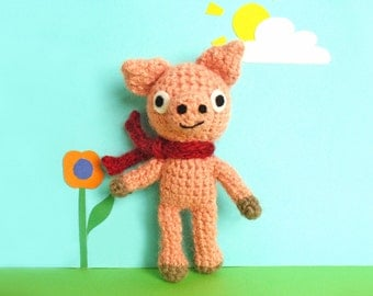 Crochet pink pig soft toy amigurumi with red scarf and cute smile