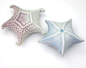 Pale blue & pink to purple glazed starfish, hand built, carved porcelain