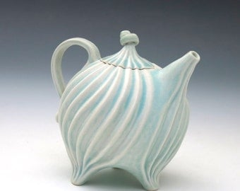 Pastel aqua blue teapot in carved porcelain