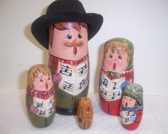 Hand painted Caroler Collection stacking nesting doll set