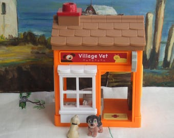 Pet Clinic with Ringing Entrance Mat and Meaowing and Barking Sound on Table. It Uses 2 Small Lithium Cells for Power. Over 7 Inches Tall.