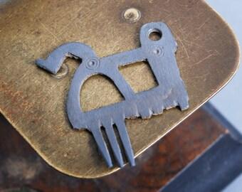 Antique plate, part of comb, broken metal comb,  finding dark patina