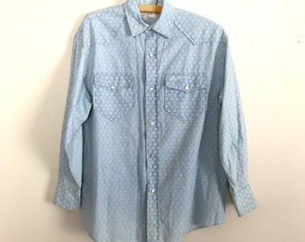 1990s Guess blue faded heart pearl snap blouse S