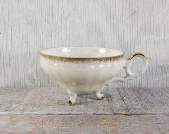 Vintage footed teacup without matching saucer, pearlescent, gold detailing, floral pattern inside cup