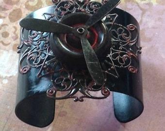 Black Cuff Bracelet Sassy Red Spinning Propeller Gothic Filigree Cross
