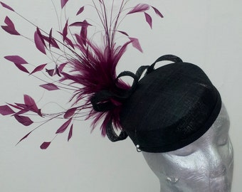 Black sinamay pillbox with burgundy coque spray.