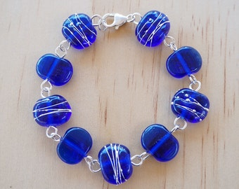 Recycled Glass Bead Bracelet.  Glass Beads made from a Skyy Vodka bottle.