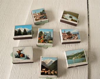 Eight vintage waxed box matchbooks scenic landmarks Switzerland Swiss Alps travel souvenir 1950s