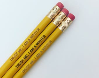 trust me, I am a writer engraved pencils in classic yellow. multiple quantities available