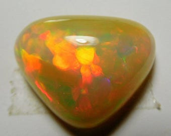 Welo  crystal opal  designer cab Huge trianglular pillow  multi color Harlequin and contra luz fire solid  14 ct