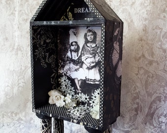 """Sisters Dream House-  wooden house shrine on stilts, paper covered with vintage French girls, flowers, moth, butterfly, leaves, 10"""" tall"""