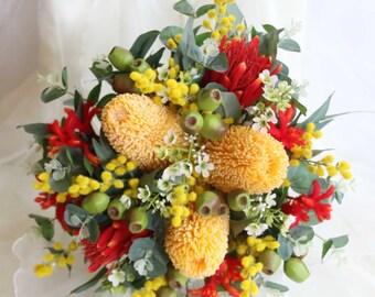 Australian native wedding bouquet Banksia, kangaroo paw, proteas,  wax flowers, wattle, gumnuts, native foliage. Red, orange, yellow flowers