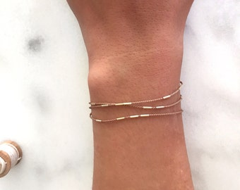 tiny gold tube bars multi wrap silk cord layering bracelet.