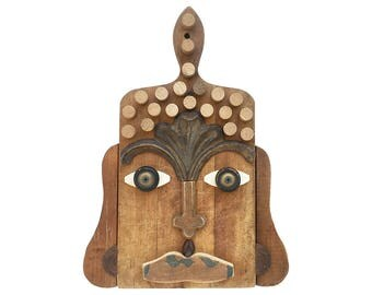 mixed media assemblage, vintage cutting board, kitchen Buddha, zen art, folk art mask  by Elizabeth Rosen