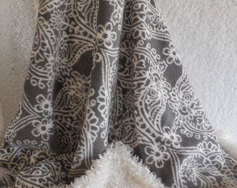 Gray and white plush minky blanket. Gray and white printed top with super soft white backing.