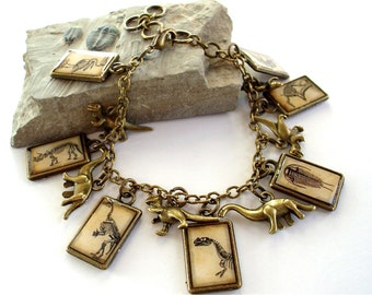 Dinosaur Charm Bracelet - March of the Dinosaurs - Double-Sided Antique Dino Print Charm Jewelry in Brass - T Rex Stegosaurus Triceratops