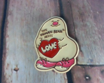 "1980's Human Bean Pin ""This Human Bean Needs Love"" Valentine's Day Button Pin Pinback C.M. Paula Co., Morgan Inc., Heart"