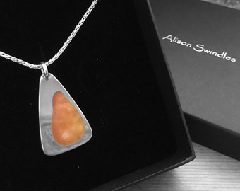 "Sterling silver pendant with orange vitreous enamel on an 18"" silver chain."