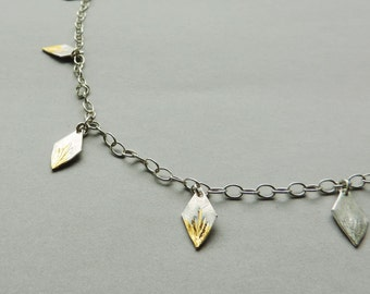 Spark Necklace, multi strand long wrap necklace in silver and gold mixed metal diamond shaped pendants.
