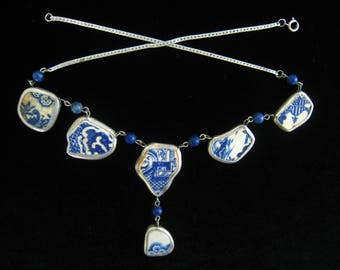Porcelain Shard Necklace with Pendant Piece and Lapis Bead Connector Links.  End Strands are Silver Herringbone Chain.