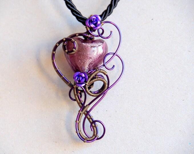 Purple lampwork glass heart pendant