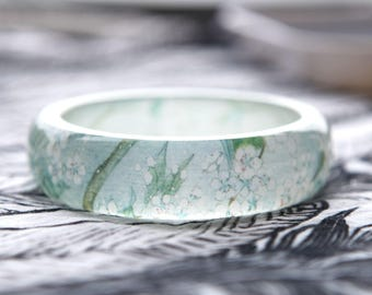 Resin bangle with embedded Asian floral art