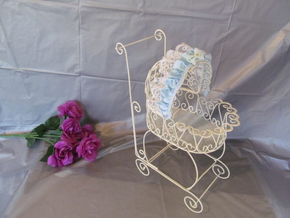 Hand decorated antique wire baby carriage for shower