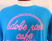 vintage 90's I saw Elvis at Adobe Rose Cafe Albuquerque New Mexico teal blue green graphic t-shirt pink slogan logo print travel souvenir xl