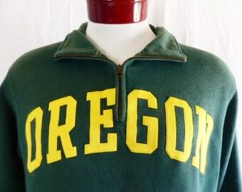 Go UO Ducks vintage 90's University of Oregon dark forest green fleece half zip graphic sweatshirt yellow gold embroider applique logo small