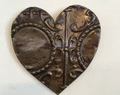 Chippy paint heart designed with antique tin ceiling tile