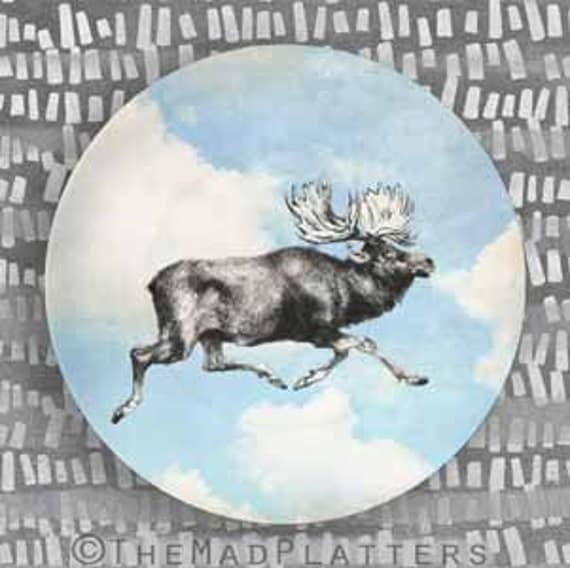 moose running in blue sky melamine plate