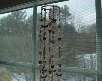 Pink suncatcher with silver dragonflies
