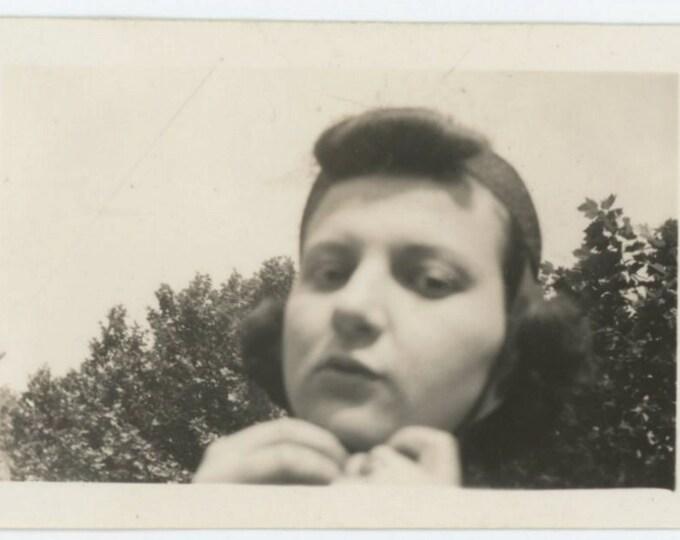 Vintage Snapshot Photo: Girl Adjusts Chin Strap, c1940s (611515)