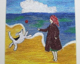 textile art, thread painting, free machine embroidery art, playful dog on the beach