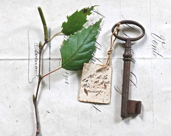 Old rusty key with its old label - the concierge's key