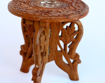 Tiny antique hand carved three legged wooden table