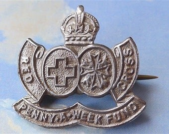 Penny-a-Week Fund British Red Cross badge, vintage.  The fund started in 1939 & ran during the 2nd. WW until 1945. King George V1 crown.