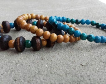 Triple Strand Bracelet with Africa Brown and Mustard Wood Beads Blonde Wood Beads and Dark Aqua Turquoise Blue Chrysocolla Beads