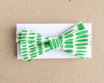 White Bow Tie with Organic Green Marks