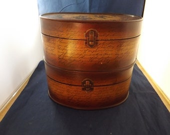Two Oval Wooden Boxes