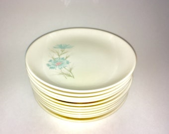"Twenty bread and butter plates in Taylor, Smith and Taylor's Ever Yours ""Boutonnière"" pattern"