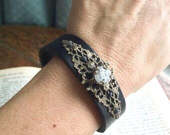 Women's Black Leather Cuff with Ornate Brass Filigree and a Millifiori Glass Cabochon